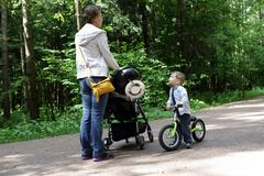 Mother with son in park Royalty Free Stock Image