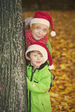 Mother and son in park with Santa hats Stock Photo