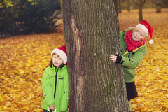 Mother and son in park with Santa hats Royalty Free Stock Images