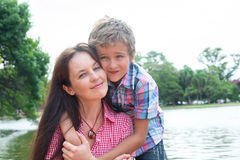 Mother and son in the park stock images