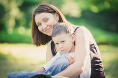 Mother and son in the park summer day. Stock Image
