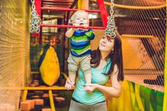 Mother and son passes the obstacle course in the sports club.  Royalty Free Stock Images
