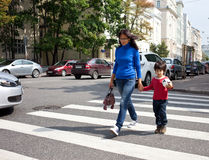 Mother and son are on a pedestrian crossing in the city Stock Image