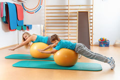 Mother and son perform gymnastic exercises Stock Image