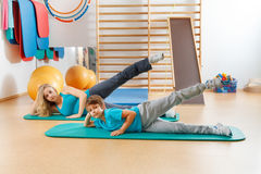 Mother and son perform gymnastic exercises Stock Images