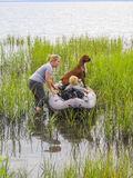 Mother, Son and Pet Dog Go Kayaking Royalty Free Stock Images