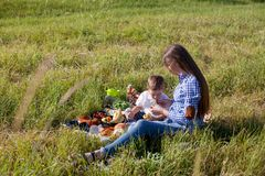 Mother and son at a picnic outdoors eating holiday. Mother and son at a picnic outdoors eating stock photo