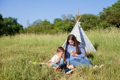 Mother and son at a picnic outdoors eating holiday. Mother and son at a picnic outdoors eating royalty free stock photo