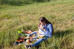 Mother and son at a picnic outdoors eating holiday. Mother and son at a picnic outdoors eating stock photography