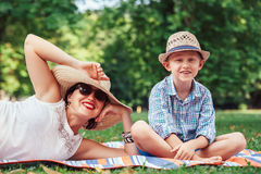 Mother with son on picnic in summer park Royalty Free Stock Images