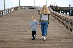 Mother and son on pier. Mother and son walking on pier royalty free stock image