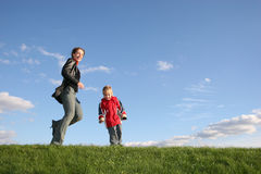 Mother with son play. On grass Stock Images