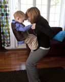 Mother and son play. Young mother and her son play at home royalty free stock photos