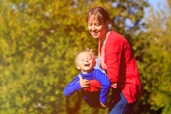 Mother and son play in autumn nature. Family fun Royalty Free Stock Images