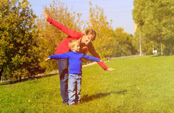 Mother and son play in autumn nature. Family fun Stock Images