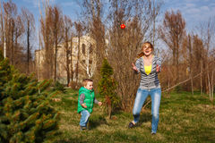 Mother and son play ball. Mom and son playing ball in the autumn park. Family time. Happiness of childhood and motherhood. Active leisure on the open air Stock Photo