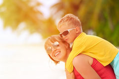 Mother and son play on the beach. Family fun Royalty Free Stock Photo