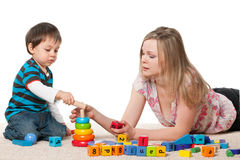 Mother and son play with blocks. Mother and son play on the carpet with blocks Stock Image