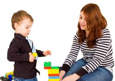 Mother and son play with bricks. Isolated Stock Images