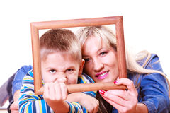 Mother and son play with empty frame. Stock Photo