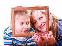 Mother and son play with empty frame. Stock Photos