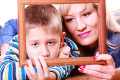 Mother and son play with empty frame. Stock Photography
