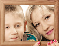 Mother and son play with empty frame. Royalty Free Stock Images