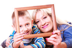 Mother and son play with empty frame. Stock Image