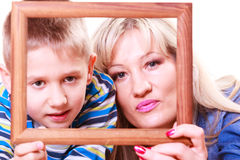 Mother and son play with empty frame. Spending time family bonds parenthood. Mother and son have fun play with empty picture frame hold in hand Stock Photos