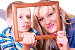 Mother and son play with empty frame. Spending time family bonds parenthood. Mother and son have fun play with empty picture frame hold in hand Stock Photo