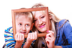Mother and son play with empty frame. Spending time family bonds parenthood. Mother and son have fun play with empty picture frame hold in hand Stock Images