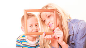 Mother and son play with empty frame. Spending time family bonds parenthood. Mother and son have fun play with empty picture frame hold in hand Royalty Free Stock Photography