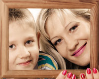Mother and son play with empty frame. Spending time family bonds parenthood. Mother and son have fun play with empty picture frame hold in hand Stock Image