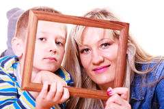 Mother and son play with empty frame. Spending time family bonds parenthood. Mother and son have fun play with empty picture frame hold in hand Royalty Free Stock Photo