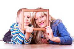 Mother and son play with empty frame. Stock Images