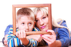 Mother and son play with empty frame. Spending time family bonds parenthood. Mother and son have fun play with empty picture frame hold in hand lay on floor Stock Photo