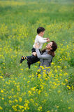 Mother and son play in flowers Royalty Free Stock Photography