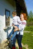 Mother with son play near the house Stock Image