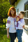 Mother with son play near the house Stock Photography