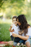 Mother and son play in park. On picnic Royalty Free Stock Photography