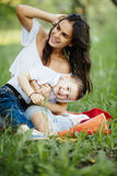 Mother and son play in park. On picnic Stock Image