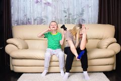 Mother and son play video games together. royalty free stock image