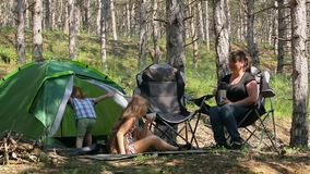 Mother and son played on a blanket in the woods. Little cute boy with his mother to spend time in nature at the campsite stock video