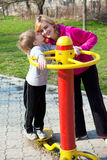 Mother with son in playground Royalty Free Stock Photos