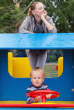 Mother and son on playground Stock Image