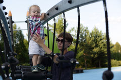 Mother with son at playground Stock Photo