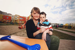 Mother with son on playground Stock Images