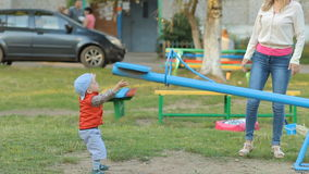 Mother and son on the Playground, play with children's constructions stock video footage