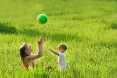 Mother and son playing. With colorful ball Royalty Free Stock Photo