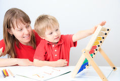 Mother and son playing with abacus Royalty Free Stock Photos